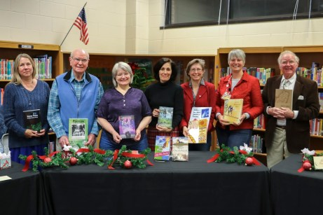 Johnston County Public Schools students, staff, parents, and community members connected with local authors at the first ever JOCO Reads event on Thursday, Dec. 6 at Selma Elementary. Featured authors included (from left) Kim Beall, Cornell Cox, Julia Day, Hope Toler Dougherty, Sherry Storrs, Evelyn Wool, and Shelby Stephenson.