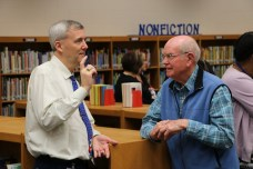 Pine Level Elementary Principal Allen Sasser (left) talks with published author Cornell Cox at the JOCO Reads event on Dec. 6.