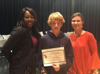 West View Elementary student Carson Philbrick (center) was the winner of the 2019 Johnston County Spelling Bee. Standing with him are West View Elementary Principal Chenetra Mangum (left), and West View Elementary teacher Kristi Beasley (right).