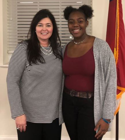 West Johnston High student Alex Johnson (right) was the Original Poetry competition winner. Standing with Johnson is West Johnston High Principal Jennifer Swartz (left).