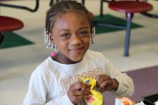 West Smithfield Elementary kindergarten student Alaisha Watson eats a school lunch in the cafeteria.