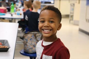 Preschool student Nicolas Faison enjoys eating in the Cleveland Elementary cafeteria at an early age.