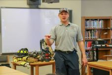 Raleigh Fire Department Captain Davey Penny speaks to a group of students about making the most out of their educations and how they will use what they learn in the real world.
