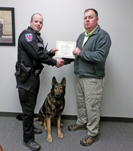 Selma Police K-9 Officer Justin Vause (left) receives the Officer of the Year Award from Police Captain Jamie Hughes. Vause is joined by his K-9 partner Major. JoCoReport.com Photo