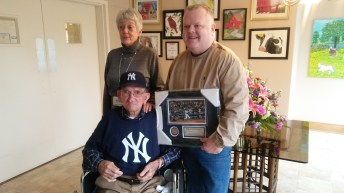 Jodi Desimone and Donnie Wood are helping raise $3,000 for Milt Capps to travel to Yankee Stadium for his 100th Birthday this June. A GoFundMe account has been established to help pay for the trip. Donnie is holding a Derek Jeter plaque presented to Milt from WTSB's Carl Lamm, who is also a big Yankees fan.