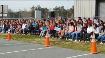 North Johnston High School juniors and seniors intently watch as local EMS, Fire Departments and State Troopers respond to the victims at the mock accident scene.