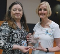 Wanda Johnson, volunteer coordinator for Johnston Health Home Care & Hospice, presents the Hospice Angel Award to Carolyn Jones for lifting spirits, and quietly touching lives.