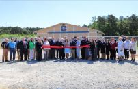 Students, JCPS staff, elected officials including former North Carolina Governor James B. Hunt, and several community members come together for the ribbon cutting ceremony of the Shelby Rose Bireley Agricultural Building at Cleveland High on May 14.