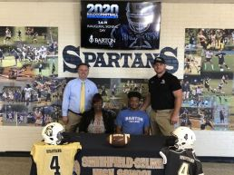 (Left to right) Smithfield Selma High Principal David Allen, Barbara Nelson Whaley, Devonte' Whaley, and SSS Head Coach Mike Parrish. Contributed photo