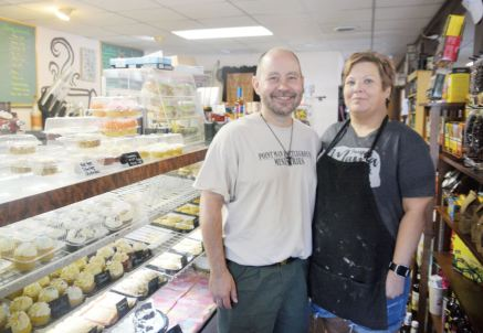 Brent and Trina Norris, owners of Inspirational Grounds and Sweet Dreams Bakery, are getting orders from around the world for a cake they designed. The cake was decorated to look like an Amazon package.