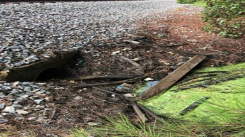 Debris clogs a drainage pipe under the railroad tracks near Noble Street. Town of Smithfield photo