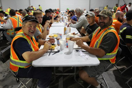 Dennis Stymiest and Mark Crandlemire were one of 114 linemen down from New Brunswick, Canada, staging at Godwin Manufacturing in Dunn, preparing to head out and restore power.
