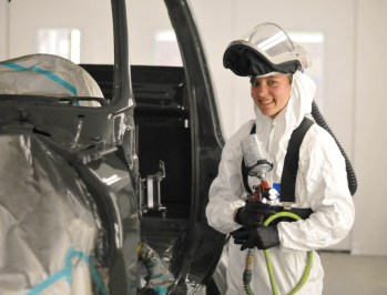 Kassidy Nixon of Lillington, a student in the Central Carolina Community College Automotive Restoration Program, works on a vehicle.