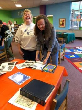 Kim Sigmon (left) and Grace Sigmon (right) enjoy West Clayton Elementary yearbooks and scrapbooks from previous years.