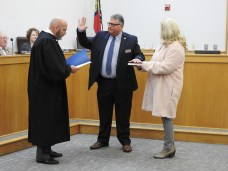 Councilman Steve Rabil receives his Oath of Office from Chief Resident Superior Court Judge Tom Lock.
