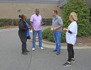 Local candidates and their supporters prepare to greet voters Thursday morning outside the one-stop early voting precinct at the First Baptist Church Ministry Center in Smithfield. JoCoReport.com Photo