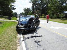 A passenger car rear-ended a white pickup truck that had stopped for the first collision.