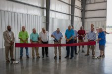 Wayne County Board of Commissioners Chairman E. Ray Mayo cuts the ribbon for a new corporate hangar at the Wayne Executive Jetport on July 16, 2020.
