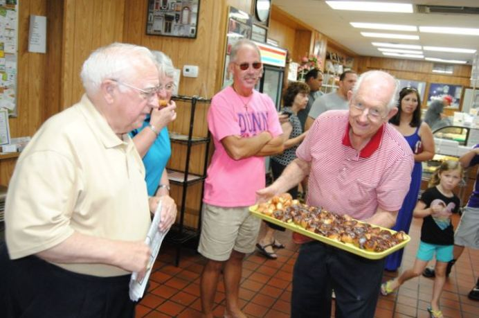 Up until a couple of years ago Freddie Williford, right, could be seen walking around Sherry's Baker, which he founded in 1967, passing out samples of chocolate-covered doughnut holes. He died Tuesday morning at the age of 88. Dunn Daily Record Photo