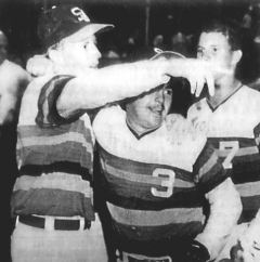 South players Chris Stephenson, left, and Chris Norris (3) celebrate after winning the 3-A state baseball championship in 1990.
