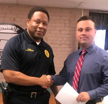 Wilson's Mills Police Chief A.Z. Williams welcomes Officer Dylan Bowen to the force. Bowen was hired in March as a part-time officer.