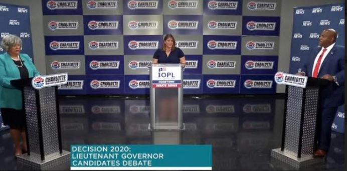 Candidates for lieutenant governor — Democratic state Rep. Yvonne Lewis Holley, left, and Republican Mark Robinson, right — debate at the Charlotte Motor Speedway as part of the N.C. Institute of Political Leadership's Hometown Debate series. At center is Spectrum News NC moderator Loretta Boniti (Screen shot from Spectrum News.)