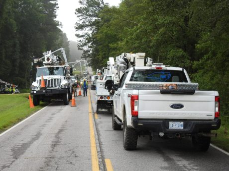 Crews work to replace power poles on Black Creek Road