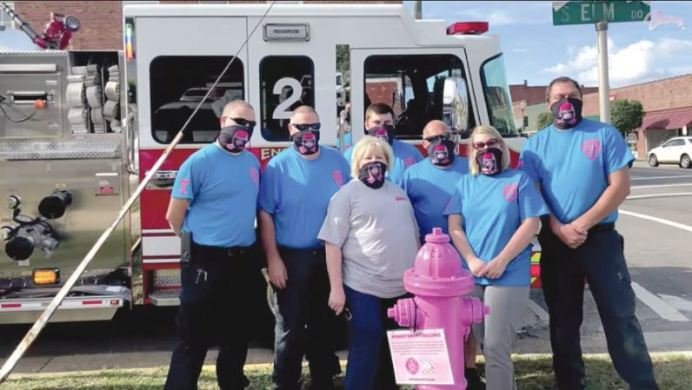 The Benson Fire Department honored Breast Cancer Awareness Month by painting two fire hydrants along Main Street pink. Posing with one of the hydrants are Zach Alexander, Benson Fire Chief Alan Johnson, breast cancer survivor and first to sign the hydrant Jenny Campbell, Andrew Peedin, Assistant Chief Anthony Byrd, Assistant Town Manager Kim Pickett and Sef Stanley. Contributed photo