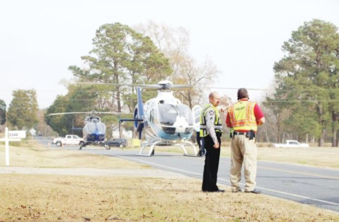 Two helicopters await passengers to transport from the scene of a bad wreck near 3340 Sheriff Johnson Road in November. Dunn Daily Record Photo
