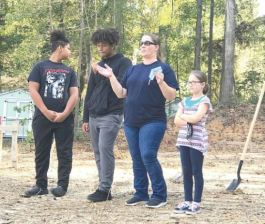 Habitat for Humanity of Harnett County breaks ground Oct. 24 on the future home of Constance Lewis and her children, from left, Dylan, Jaylan and Cayla. Contributed photo