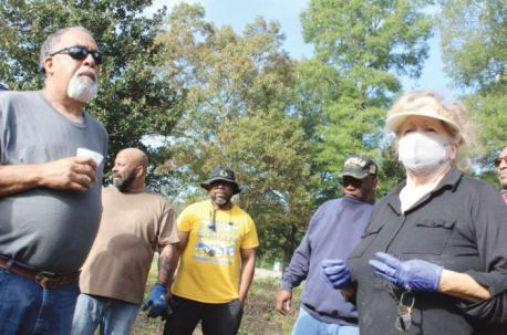 Joy Williams, right, thanks a host of volunteers for helping clean up the Wilkins Cemetery at the end of Wilson Avenue in Dunn Saturday morning. She is surrounded by volunteers, from left, Neal Jones, club founder of the Buffalo Soldiers in Raleigh Dwain Brown, Randy 'Little Supe' Rawlins and Hurley 'Cass' Jones. Dunn Daily Record Photo