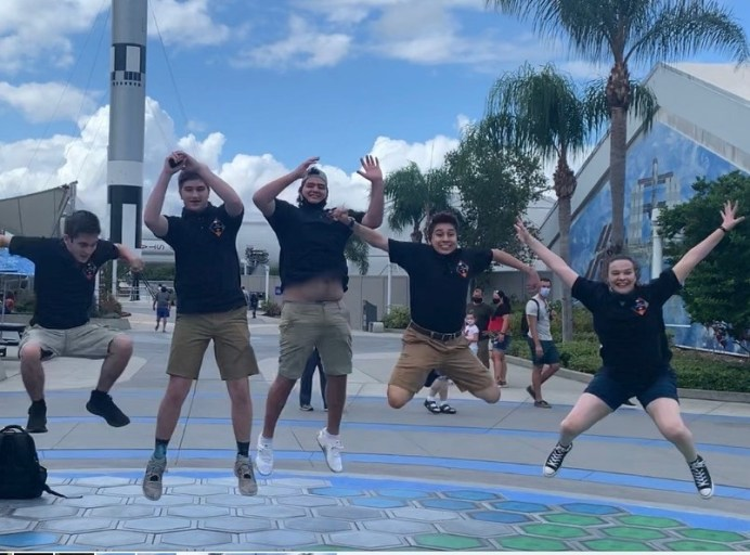 """Students from N.C.'s f(x) First in Orbit CubeSat team show their excitement at being able to present at Kennedy Space Center as they participate in KSC's """"Step, Power, Launch"""" experience trying to generate energy by jumping on piezo tiles. Photo by Dunja Nascimento-Wilson"""