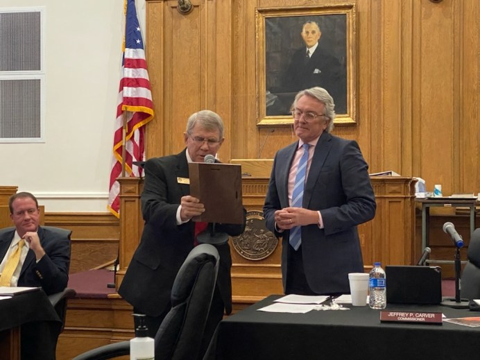 (Left to Right) Board Chairman Ted Godwin present retiring County Commissioner Jeff Carver a plaque on Nov. 2, 2020 thanking him for 18 years of service as a Johnston County Commissioner.