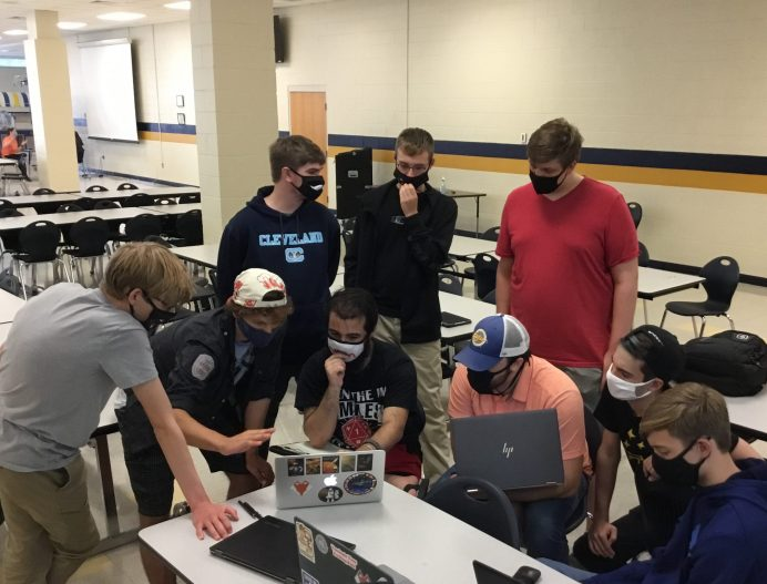 Members of the f(x) First in Orbit team meet at Smithfield-Selma High School in November to discuss their NASA payload proposal. This historical team is made up of students from across Johnston County. Photo by Sloan Mann