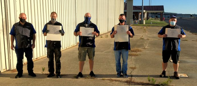 Four students in Wayne Community College's Aviation Systems Technology program have completed requirements necessary to sit for the Federal Aviation Administration General and Airframe Mechanic exams. Along with Instructor Mike Crumpler (far left), they are (left to right) Stephen Gilbert, Jared Rhynehart, Kevin Welton, and Jeffrey Gollbach.