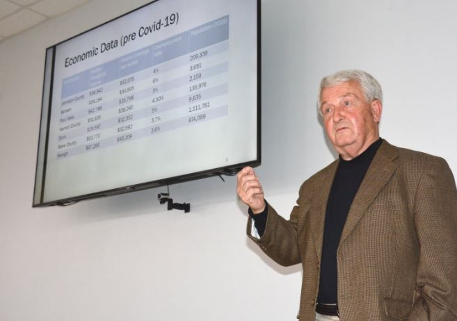 Four Oaks Mayor Linwood Parker speaks to leaders from Dunn, Benson and Four Oaks about the formation of the I-95/I-40 Crossroads of America Economic Planning Alliance during a joint meeting Thursday night at the Dunn Community Center. Dunn Daily Record Photo