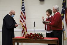 Lyn Andrews receives her oath of office from Superior Court Judge Tom Lock. JCPS Photo
