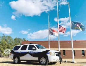 A photo posted on the Facebook page for Harnett County Emergency Services shows flags at half-staff after the killing of Sarah Lewis, a paramedic there.