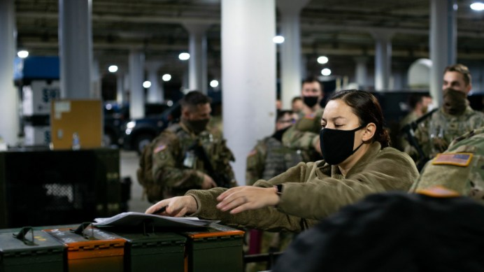 U.S. Army 1st Lt. Estefany Torres, North Carolina National Guard, distributes weapons and ammo to Soldiers at the armory in Washington, D.C., Jan. 20, 2021. U.S. Army National Guard photo by Sgt. Abraham Morlu