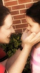 parent holding cheeks of child soft