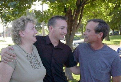 U.S. Navy Corpsman Matt Clayton with his parents