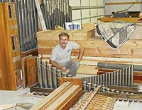 Rick Darrow with some of the Wurlitzer's pieces