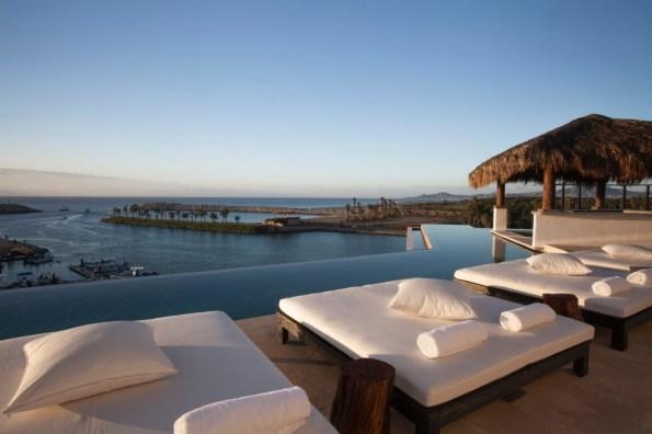 Beach loungers overlooking ocean