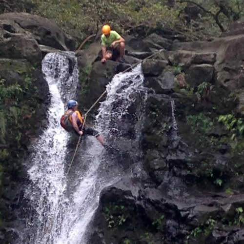 rappelling down a waterfal