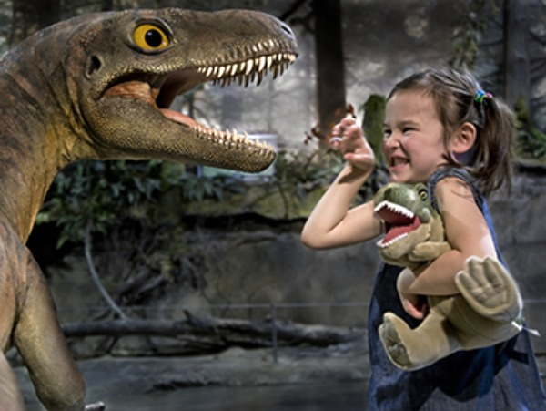 child with dinosaur