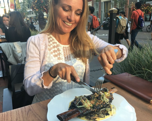 woman eating short rib
