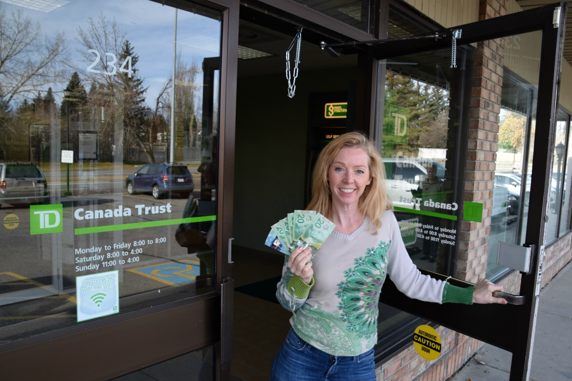Woman leaving bank with cash