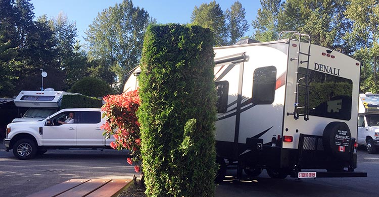 Moving into our Fifth Wheel to start our RV life. Backing in the Fifth Wheel the first time was incredibly difficult, as we had been given a tight, difficult spot. Attila had to take over and get it done. Without him, we would have been in serious trouble