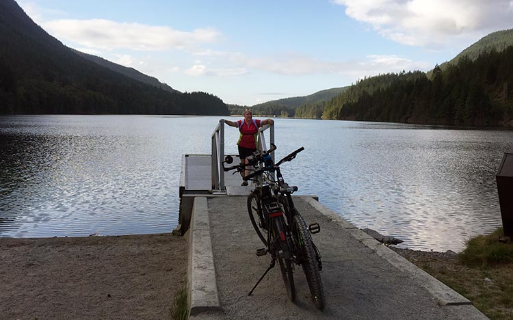 Biking and Hiking Near the Anmore RV Park in the Buntzen Lake Area, British Columbia. Here are our bikes parked at North Beach. And Maggie too!