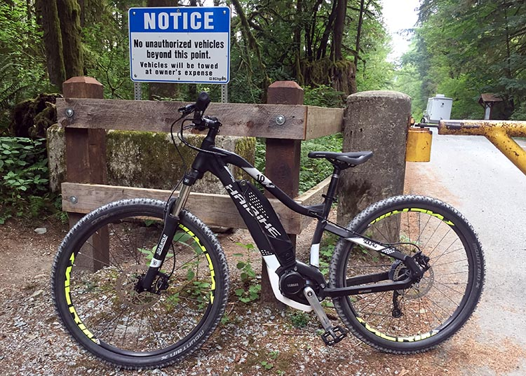 Cycling near Buntzen Lake, British Columbia, Canada. You can access this service road in Buntzen Park by pushing your bike through a turnstile. This is Maggie's bike leaning up against the turnstile